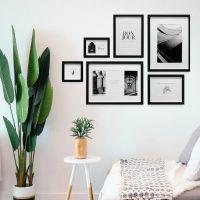 Mur de photos avec 6 cadres noirs